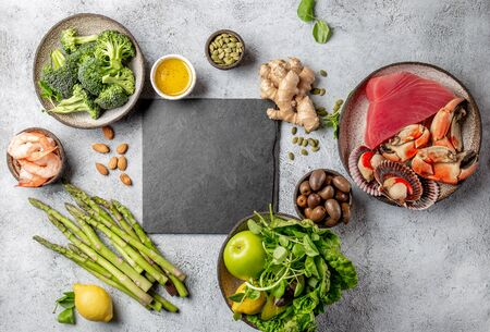 Healthy Clean eating concept. Vegetables, seafood, oil, Food background with copy space. Zdjęcie Seryjne