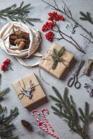 Zero waste Christmas concept. Natural Chirsmas decoration and Hand crafted gifts without plastic. Flat lay, top view.