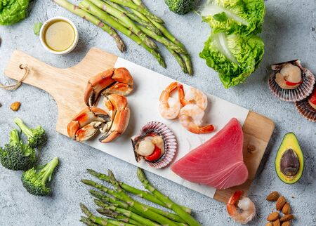 Healthy Clean eating concept. Vegetables, seafood, oil, Food background with copy space. Imagens