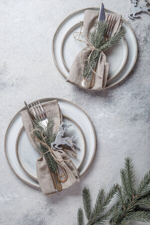 Cristmas table cutlery set with holiday decoration. Top view, copy space. Stock Photo