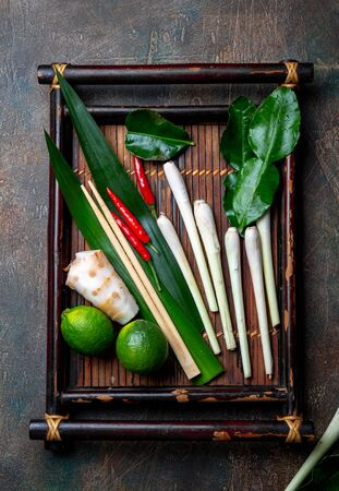 Thai herbs and spices for thai cuisine on autentic thai tray, top view