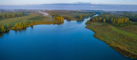 Sunset aerial atmospheric view on river in Ural Russia. Drone photography.