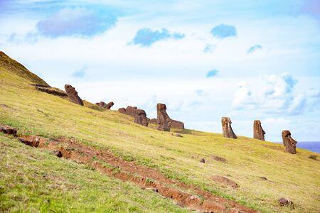 Moai on Ranu Raraku Volcan. Ester Island Landscape.