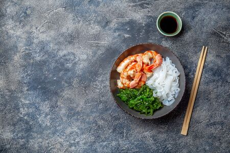 Shirataki noodles, shrimps and seaweed chuka bowl. Healthy low carbs, low calories lanch.