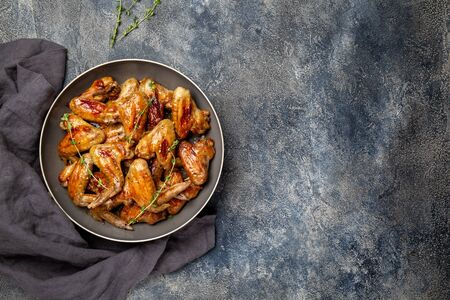 Roasted chicken wings in sweet sauce. Top view copy space.