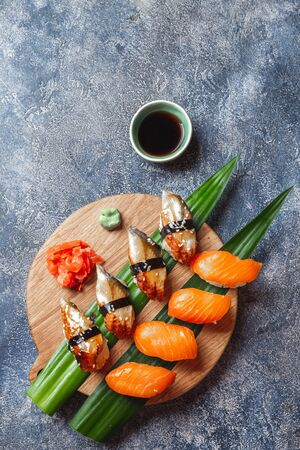 Sushi set on wooden table. Japonese food. top view.