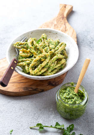 Pasta Lorighittas of Sardinia. Loriguittas with herb sauce pesto. in White plate.