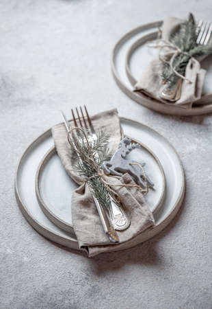 Cristmas table cutlery set with holiday decoration. Top view, copy space Imagens