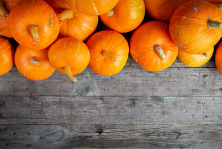 Autumn background for text with pumpkins. Top view. Copy space