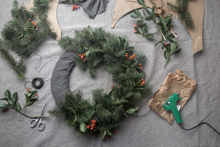 Making Christmas wreath. New year holiday decoration.