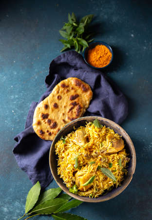 Pakistani and Indian chicken Biryani rice with mint and naa bread