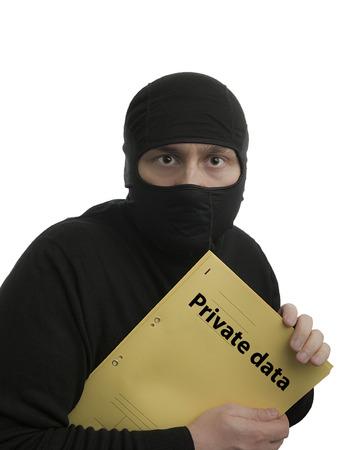 datos personales: Un ladr�n de datos con el archivo de datos personales Ingl�s Foto de archivo
