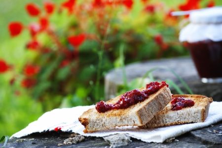 toast with raspberry jam for a delicious breakfast photo