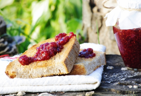 a healthy breakfast made of toast and homemade raspberry jam photo