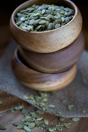 typical: Pumpkin Seeds in Soft Light in Three Stacked Wood Bowls