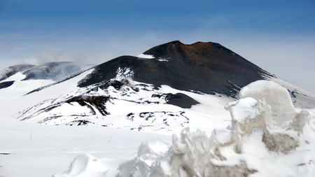 ashy: View to the snowcovered Maincrater of the Mount Etna, Sicilia, Italy, 2009.