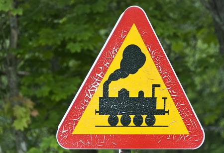 risiko: road sign with a warning of crossing steamlocomotivs Stock Photo