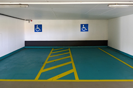 parking spaces: two marked parking spaces for the disabled at a covered car park, Vienna, Austria