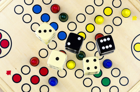 easing: Dices on the board game parcheesi or ludo