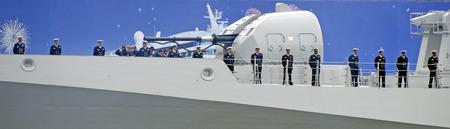 mustered: crew at the railing of the Indian warship INSTeg, Hamburg harbor birthday 2012 Germany