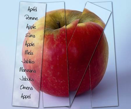 Red apple with stripes of glass and multilangual labeling