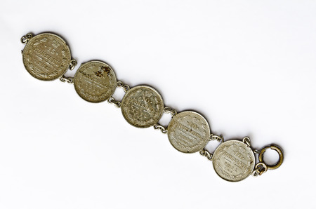 number 15: bracelet made from  russian 15 and 10 copecks silvercoins from 1913 and 1914 with numbers Stock Photo