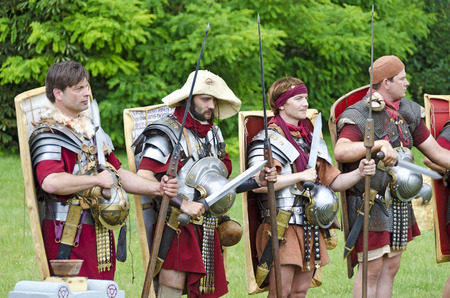 legionaries: legionaries from the Legio XV Apollinaris Austria after a 140 km march, Roman festival 2014, Carnuntum, Austria