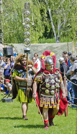 commander: commander of the roman camp and standard with awards, Roman festival 2014, Carnuntum, Austria Editorial
