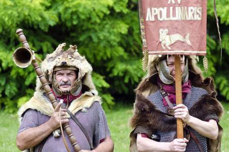 bearer: hornblower and standard bearer of the Legio XV Apollinaris Hungary, Roman festival 2014, Carnuntum, Austria Editorial