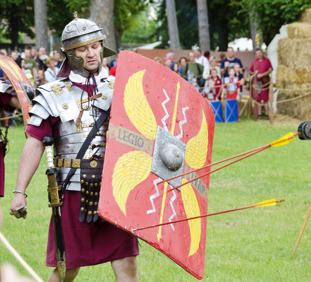 roman legionare with shield and stucked arrows, Legio XV Apollinaris Hungary, Roman festival 2014, Carnuntum, Austria