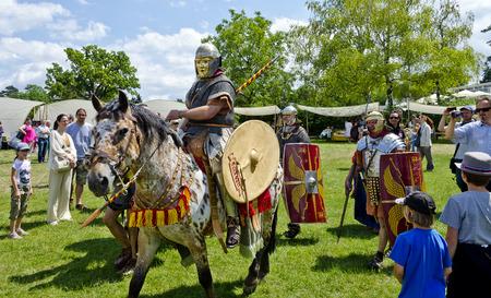 legionaries: mounted soldier from the Legio XV Apollinaris Austria after a 140 km march, Roman festival 2014, Carnuntum, Austria
