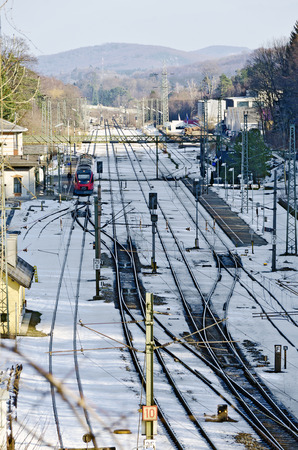 railway points: train station with snow-covered track layout at winter, Rekawinkel, Austria
