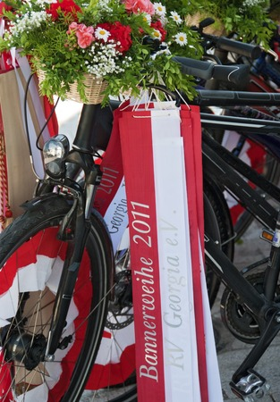 decorated bike: bycicles with flowers and flag on occasion of the consecration of a banner of the RV Georgia 2011 at the isle of Reichenau, Germany Editorial