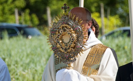 priest with precious monstrance on occasion of the consecration of a banner of the RV Georgia 2011 at the isle of Reichenau, Germany