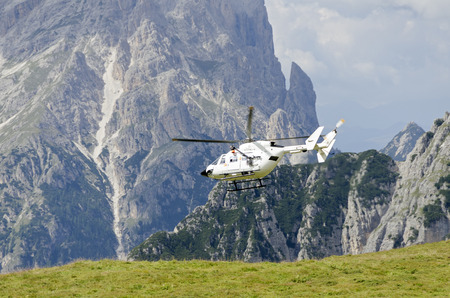 heli: rescue helicopter at the Three Peaks of Lavaredo, South Tyrol, Italy Stock Photo