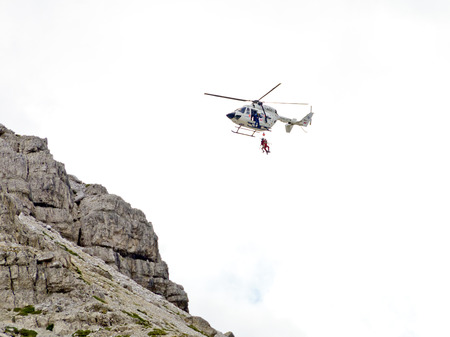 heli: helicopter rescue of a hiker at the Three Peaks of Lavaredo, South Tyrol, Italy