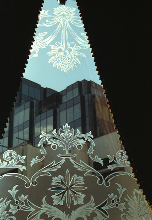 etched: windowglass with etched ornaments between half opened curtains, London, Great Britain