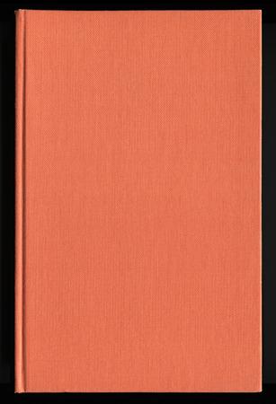 book cover made from orange cloth Standard-Bild