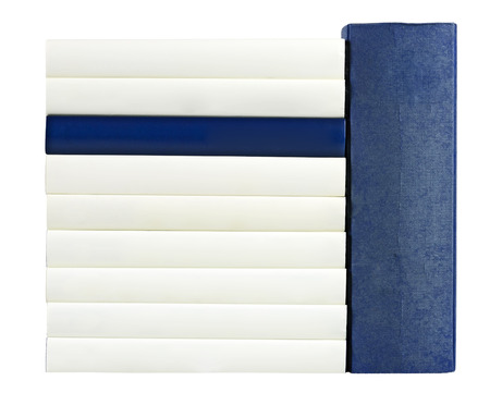 unlabelled: Pile of books with saddles in blue and white