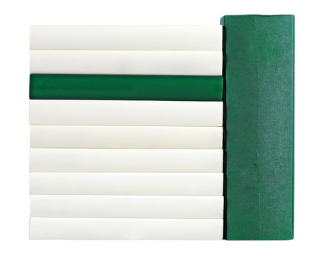 unlabelled: Pile of books with saddles in green and white