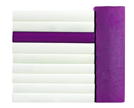 unlabelled: Pile of books with saddles in purple and white