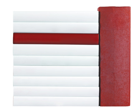 unlabelled: Pile of books with saddles in red and white