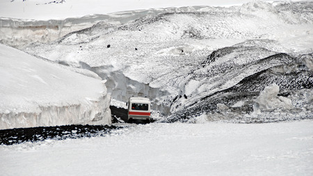 Ride with the bus to the maincrater on the snowcovered Mount Etna, Sicily, Italy, 2009. photo