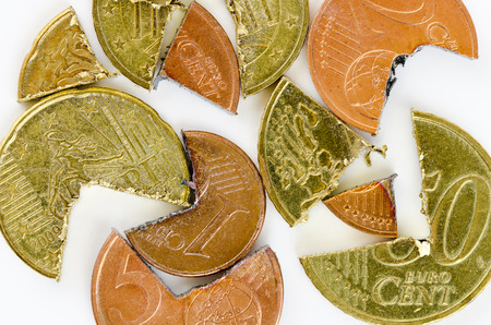 worthless: Euro-Cent coins cutted in two pieces Stock Photo