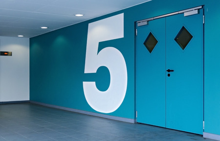 Doorway to the blue painted level 5 at a covered car park, Vienna, Austria