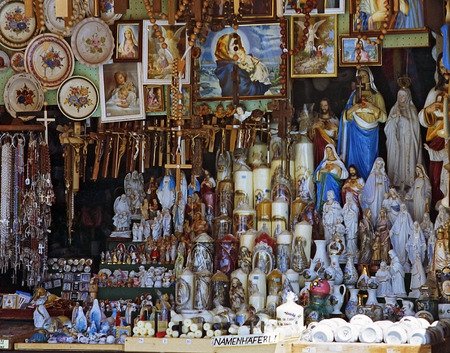 crucifixes: window of a shop with devotional objects at the pilgrimage destination Mariazell, Styria, Austria.