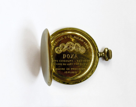 analogous: the inner side of an open pocket watch with engraved awards