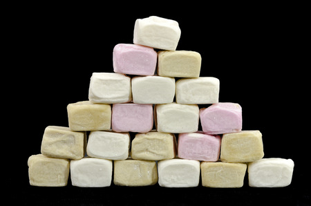 marshmellow: Pyramid made from different colored marshmallow cubes Stock Photo