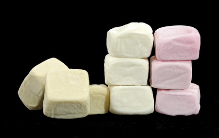 collapsed: collapsed wall made from different colored marshmallow cubes