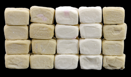 expectorant: wall made from different colored marshmallow cubes Stock Photo